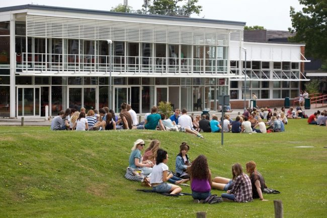British and international exchange high school students relaxing outside of a UK state college in England