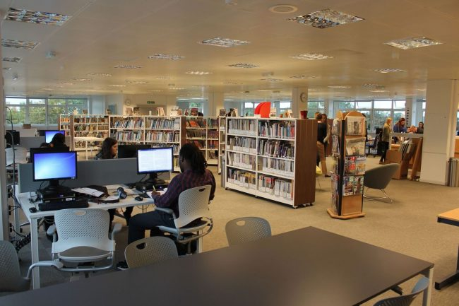British and international high school students studying in the library of a UK state college in England