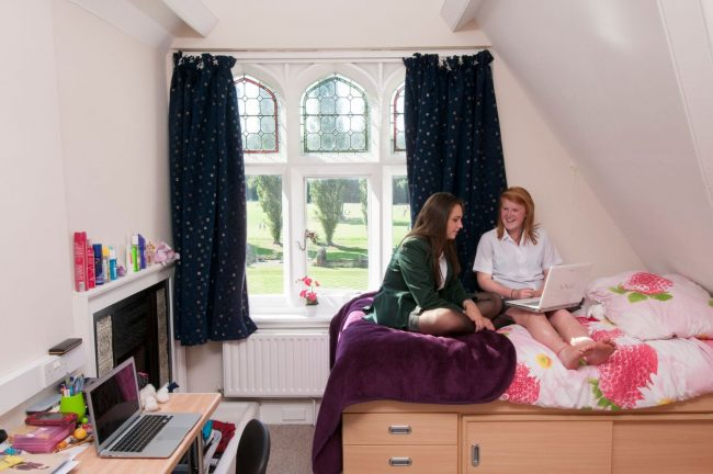 Irish student and exchange student share dormitory in Irish boarding school