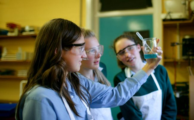 Exchange students with Irish students in science class at high school in Ireland