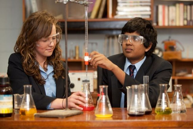 Irish student and exchange student in science class at an Irish school