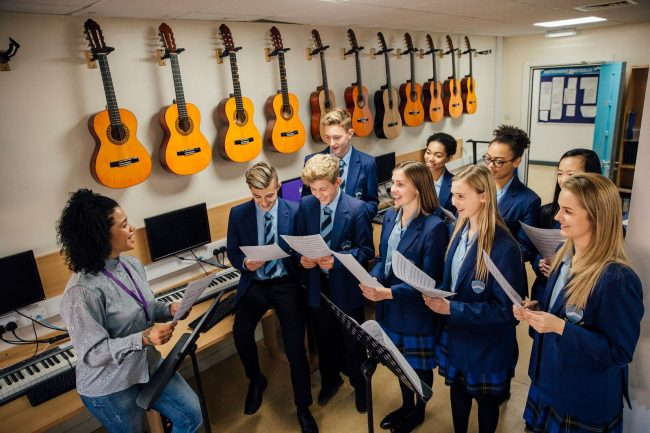 Irish students and exchange students in music class at an Irish school