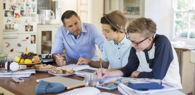 Host father helps students with school work